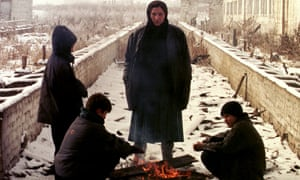 Chechen refugees stand around a fire in the village of Nasyr-Kort during the second war. Chechnya