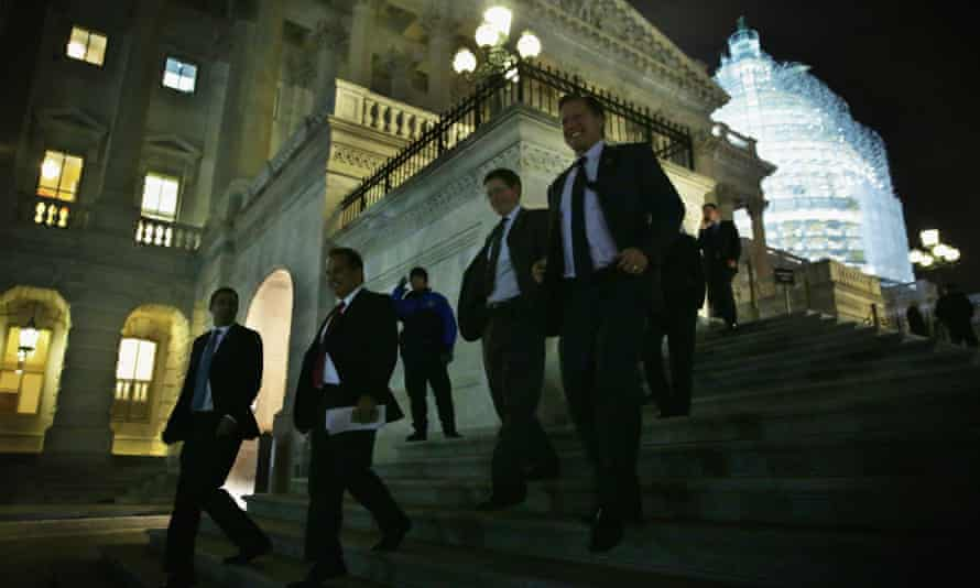 Members of the House of Representatives leave after the vote on the $1.1tn omnibus spending bill.