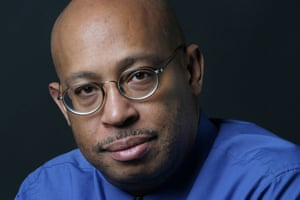 A file photograph of Michel du Cille, a photographer and former photo editor with The Washington Post, taken in 2004. The three time Pulitzer Prize winner, du Cille died 11 December 2014 while on assignment chronicling Ebola patients and their caretakers for the Post in Liberia. He was 58