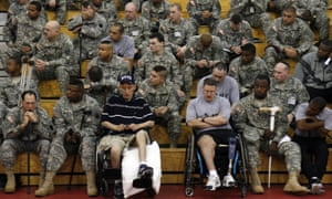 A profile on Walter Reed Medical Center's new Warrior Transition Brigade. Wounded soldiers listen to Army Major General Eric Schoomaker during a joint formation. Wounded soldiers who are able are required to attend morning formation. They remain seated on bleachers in a gymnasium