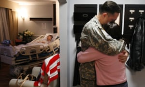 Robert Riddle, is dying of melanoma that spread to his brain, falls into a drug induced sleep a few days near the end of his life, family friend Army Col. Dan Baggio(left) comforts Riddle's wife, Army Col. Rebecca C. Samson (right). They are pictured in a special room at Walter Reed