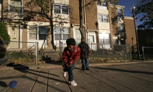 Nakia Pearson, 12, play in the courtyard on First Terrace with Alante Maybin,12. Sursum Corda has been a troubled low income housing complex
