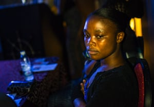 Decontee Davis, an Ebola survivor, spends a moment alone pondering during a music video launch party to raise awareness on Ebola Wednesday 12 November 2014 in Monrovia, Liberia