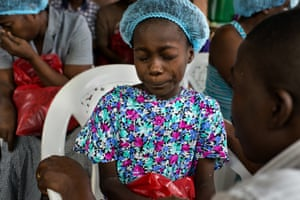 sther Tokpah, 11 an orphan, weeps as Dr. Jerry Brown tries to console her before she was released from care 24 September 2014 in Monrovia, Liberia