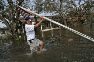 LA  Southern areas closer to the Gulf that was affected by hurricane Rita received the brunt of Hurricane RIta's destructive force. Ernest Westlund rescue his flag pole from flood waters infront of his house