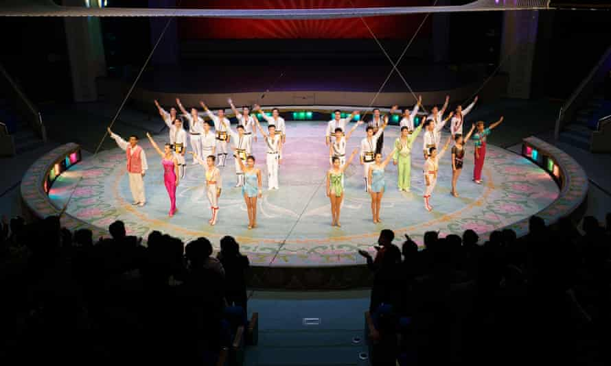 Performers salute the applauding audience at the end of their show at the Pyongyang Circus. North Korea