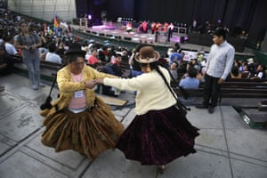 """Two Andean Indian women, dance during the inauguration of the """"People's Summit"""" in Lima, Peru, Monday, Dec. 8, 2014. The """"People""""s Summit"""" is an alternative forum that demands that climatic justice should be reflected in international and national policies, and will be held parallel to the Climate Change Conference 'COP20'."""