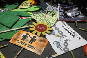"""Posters left by participants of a march in """"Defense of Mother Earth"""" sit on the floor, in Lima, Peru, Wednesday, Dec. 10, 2014. Thousands marched in support of Mother Earth as they chanted slogans against illegal mining, and logging operations, as well as oil drilling. (AP Photo/Martin Mejia)"""