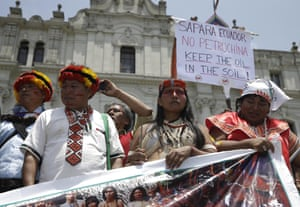 """Indian from Ecuador participate in a march in """"Defense of Mother Earth"""" in Lima, Peru, Wednesday, Dec. 10, 2014. Thousands marched in support of Mother Earth as they chanted slogans against illegal mining, and logging operations, as well as oil drilling. They asked that the exploitation of resources in their ancestral lands be stopped immediately."""