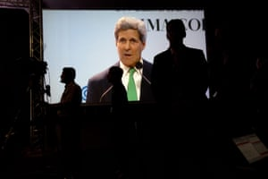 A live image of U.S. Secretary of State John Kerry giving a speech covers a screen during the U.N. Climate Change Conference in Lima, Peru, Thursday, Dec. 11, 2014. Kerry is in Lima along with delegates from more than 190 countries to work on drafts for a global climate deal that is supposed to be adopted next year in Paris.