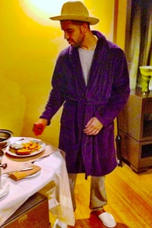 All in good taste? Drake eats his cheddar while wearing a wide-brimmed Panama hat.