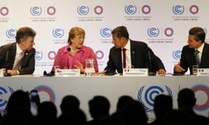 Colombia's President Juan Manuel Santos, left, Chile's President Michelle Bachelet, second left, Peru's President Ollanta Humala, second right, and Mexico's President Enrique Pena Nieto chat during the signature of an agreement of the Pacific Alliance, at the Climate Change Conference in Lima, Peru,  Dec. 10, 2014. Delegates from more than 190 countries are meeting in Lima, to work on drafts for a global climate deal that is supposed to be adopted next year in Paris.