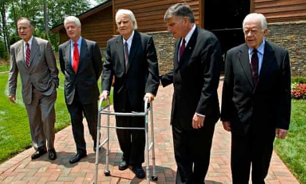Franklin Graham (second from right) leads his late father Billy, flanked by former US presidents Geo