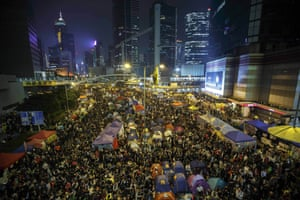 Pro-democracy protesters gather at the Occupy Central protest site in the Admiralty district, Hong Kong. The authorities urged the protesters to pack up their tents, saying it could not promise that there would be no 'confrontations'