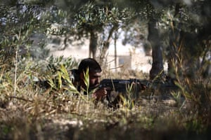 In another photograph by Abd Doumany, a young Syrian man takes part in final training before being sent to the frontline along with rebel fighters from the Jaysh al-Islam brigades in eastern al-Ghouta, a rebel-held region outside Damascus