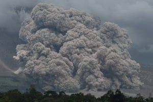 Smoke spews from Mount Sinabung in Karo, Indonesia, as the volcano continues to intermittently erupt. Residents who lived in the danger zones around the volcano were relocated following the deadly eruptions that killed 17 people in February