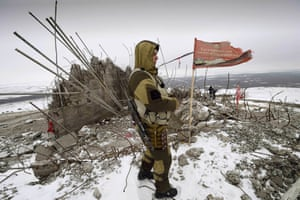 A Donetsk People's Republic soldier is photographed at the damaged Savur Mogila monument near the city of Snizhnee in eastern Ukraine. The monument honours Red Army troops who fell during the second world war