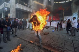 In Mexico, farmer Agustin Gomez Perez sets himself alight in protest outside the Chiapas state legislature in Tuxtla Gutierrez. Perez was demanding the release of his father, indigenous leader Florentino Gomez Giron, who was arrested last year on charges stemming from a series of demonstrations in 2011 that turned violent. Agustin was taken to a hospital, where his stepmother, Araceli Diaz, said he was in a serious but stable condition
