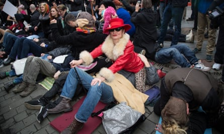 Face-sitting protest outside parliament in London