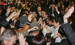epa04526048 Japanese Prime Minister Shinzo Abe (R) exchanges high fives with voters during an election campaign after speaking in Urawa, Saitama Prefecture, north of Tokyo, Japan.