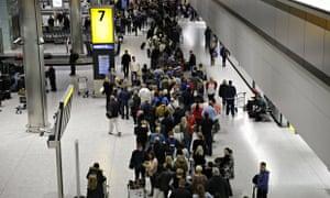 People queue at Heathrow airport