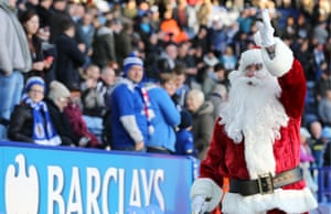 Santa Claus waves to the crowd before kick-off at Leicester versus Manchester City