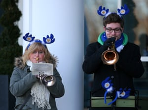 A brass band play Christmas carols before the game