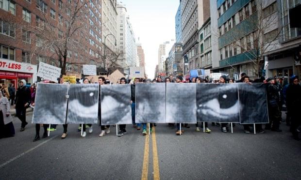Eric Garner eyes signs