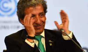 COP20 president and the Peruvian minister of environment, Manuel Pulgar, claps after approving the proposed compromise document.