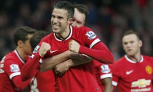 Robin Van Persie celebrates scoring the third goal for Manchester United.