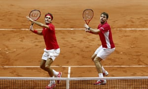 Roger Federer and Stanislas Wawrinka of Switzerland in action against Richard Gasquet and Julien Benneteau of France in the doubles during day two of the Davis Cup final.