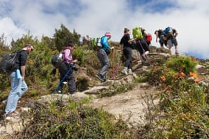 Namche Bazar.A tour group trek from Namche Bazar, for a view of Everest in the surrounding mountains. Despite Everest not being officially closed by the government this season, 2014 permits to climb Everest, can be used over the next five-years by the trekkers who were unable to climb.