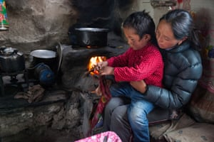 Dingboche.Pasang Lhama Sherpa, 28, and her five year old son making tea in their teahouse in DIngboche. Not making much money in her teahouse as not many people visit, she is worried about the future and her sons education. She said her husband Then Dorje Sherpa did not love climbing, but it was the only job available to him due to his lack of education. Like most other summiters it is the only job they can find. Having not received any compensation form the Nepali government, she also has not received any money form the insurance company as she must travel to Kathmandu to collect the sum, but cannot afford to buy a ticket to the capital.