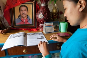 Kavresthali, Jwaranku, Banantanagar, Northern Khathmandu suburbs-  Doma Khatri, 21, looks at her father  s memorial; Dorje Khatri, leader of Nepal  s Trade Union of Sherpa  s was amongst the 16 killed in Everest  s worst disaster recorded, in April. Like all the other families of those who died, Doma Khatri and her family have yet to receive any compensation or support from the government.