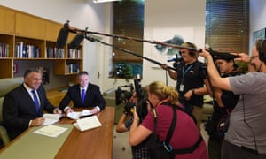Treasurer Joe Hockey and the finance minister, Mathias Cormann, preparing to deliver Myefo at Parliament House in Canberra.