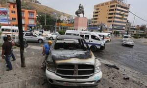 A damaged vehicle seen after the clashes in Chilpancingo.