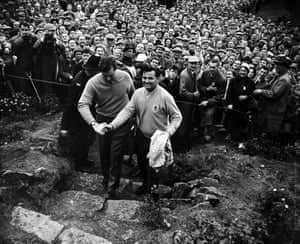 1957 Dai Rees  The Great Britain captain Dai Rees shakes hands with foursomes partner Ken Bousfield, after their victory over American pair Art Wall and Fred Hawkins by one shot, as the massed crowds look on.  The victory meant that Great Britain and Ireland won the 1957 Ryder Cup by 7-4