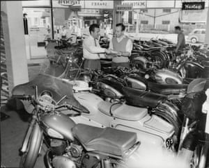 1959 John Surtees  Motorcycle Champion John Surtees (right) in his West Wickham shop seen discussing business details with his Shop Manager Mike Marriott