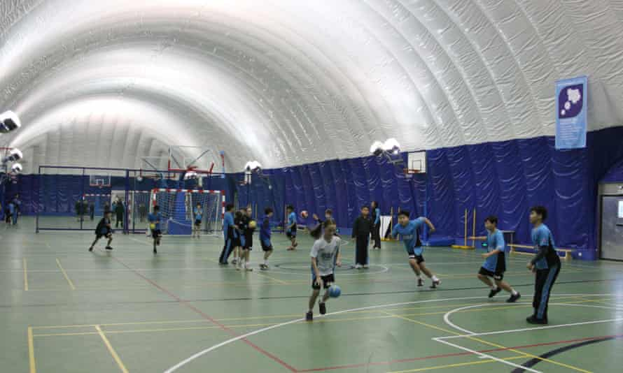 A sports class inside the inflatable clean-air dome at the British School of Beijing.