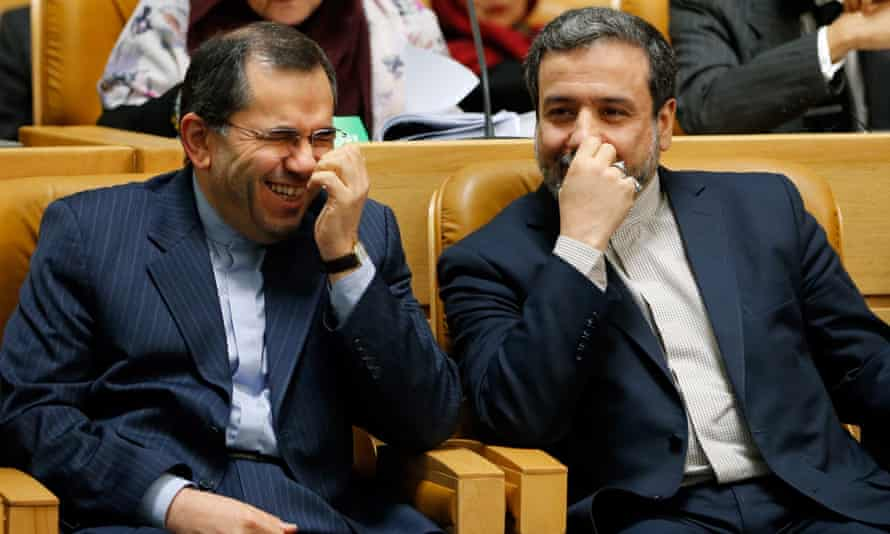 The two Iranian deputy foreign ministers Abbas Araghchi (R) and Majid Takht Ravanchi (L), who are leading the Iranian negotiating team in Geneva, share a light moment during the opening session of the international 'Together Against Violence and Extremism' conference in Tehran, Iran, 9 December. Araghchi later briefed a closed-door parliamentary session about the latest developments of the nuclear talks EPA/ABEDIN TAHERKENAREH