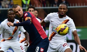 Roma's defender from France Mapou Yanga-Mbiwa  fights for the ball with Genoa's defender Luca Antonelli