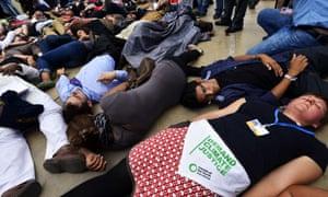 Acitivists demonstrate at the UN COP20 climate change conferences