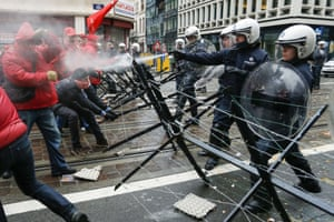 Union members clash with the police outside the N-VA office in Brussels during a national general strike on December 15, 2014 in Brussels.