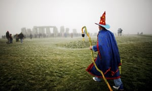 A solstice participant makes his way to Stonehenge.