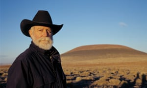 James Turrell in front of Roden Crater at sunset.