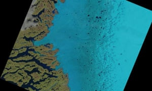 Supraglacial lakes on the Greenland ice sheet can be seen as dark blue specks in the centre and to the right of this satellite image.