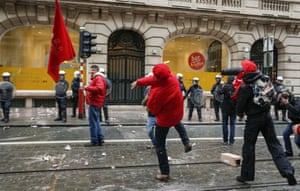 Union members throw projectiles at the VOKA headquarters in Brussels during a national general strike on December 15, 2014 in Brussels..