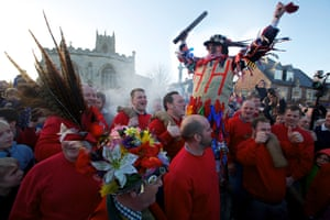 Smoking the Fool … a fire is lit under the Fool who makes a welcome speech before officially starting the Haxey Hood.