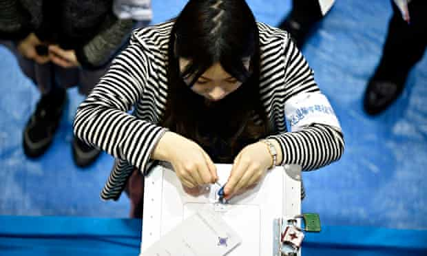Opening a ballot box in Japan's recent general election … only 169 women stood out of 1,093 candidat