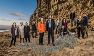 Sands of time: with co-star Olivia Colman and other cast members of Broadchurch, in Dorset.